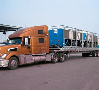 One of Drill Cool's GCFX Geo-Chillers being transported on a semi-truck